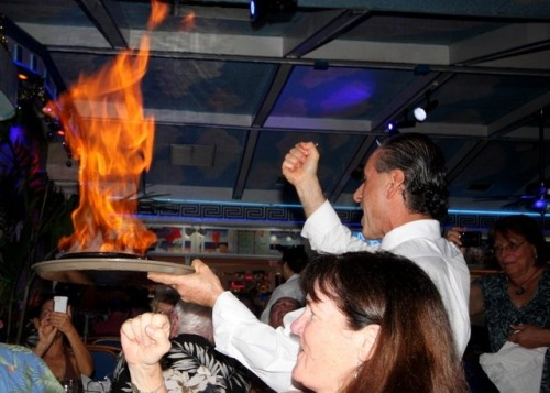 "Everyone at Hellas Restaurant has to try the flaming cheese and yell ""OOPA!"" when they fire it off.  They fire it off with Greek brandy that could also be used in Memsahib's stove in a pinch."