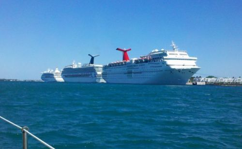 "Cruise ship row as we entered Key West Harbor.  Can you hear me thinking, ""Please, please don't move til I get past."""