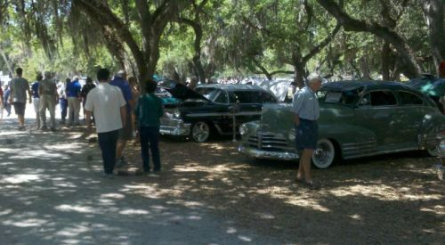 Car show in the live oaks and spanish moss.
