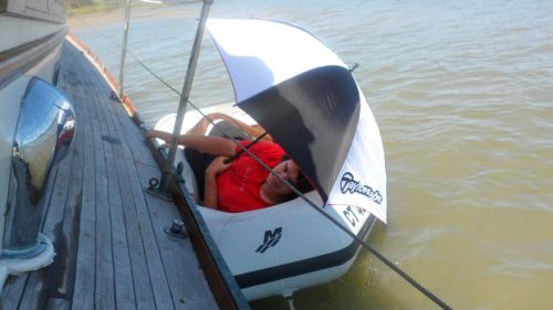 John abandons ship for a nice, level nap in the dinghy.