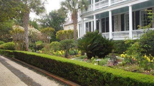 Many of the single houses have elaborate small gardens facing the verandas.