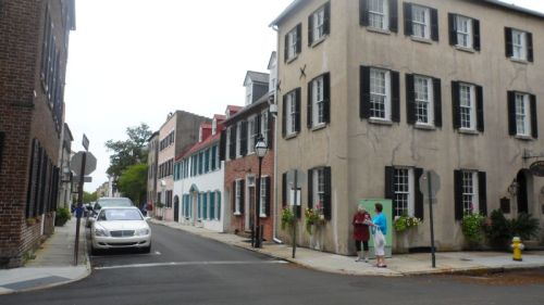 Very early row houses (1740) row houses on Tradd Street running into Church.